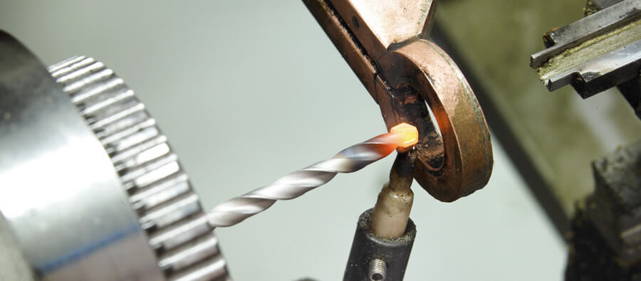 Induction brazing of carbide tips, blades and bits
